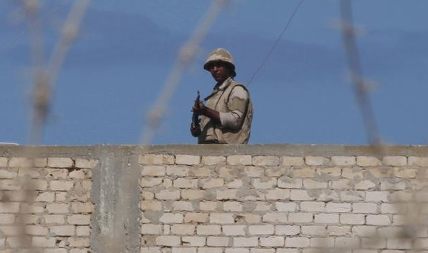 An Egyptian soldier guards the border between Egypt and southern Gaza Strip