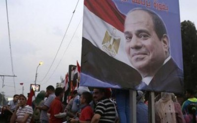 Egyptians celebrate after swearing-in ceremony of President elect al-Sissi in Cairo